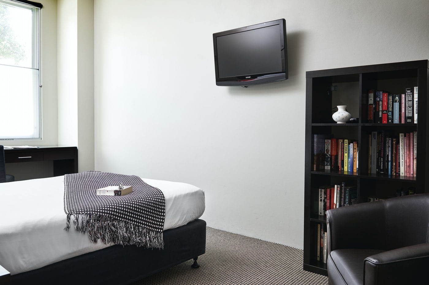 superior room features a book shelf Vulcan Hotel Boutique Accommodation
