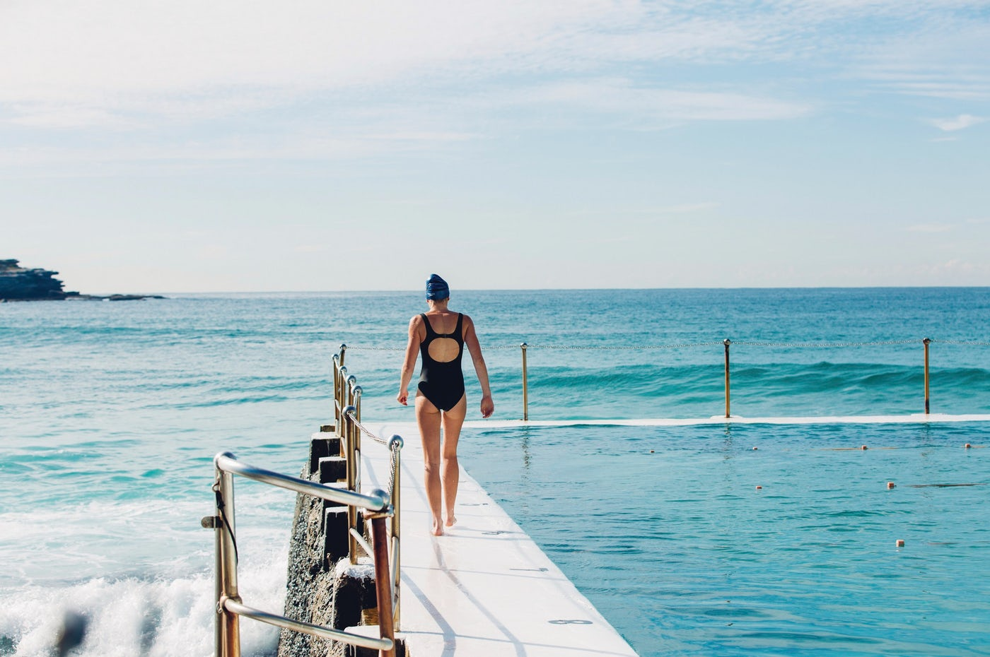Woman out for a morning swim at Bondi Icebergs, Bondi Beach.